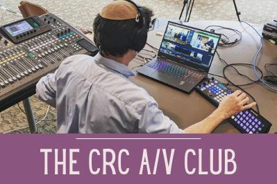Rabbi Daniel controls cameras and livestream as he produces a CRC service.