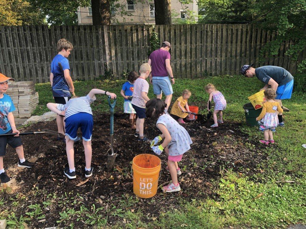 Grade school children pick fresh local produce from the CRC mitzvah garden